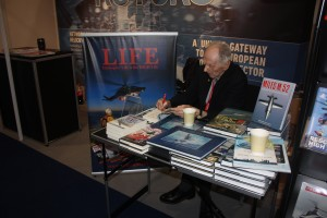 Eric Brown signing his books on the Helicopter Life booth at HeliTech 2015